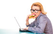 Hungry girl eating sandwich on work