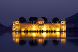 jal mahal palace on lake at night in India