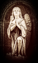 Vintage image of an angel praying