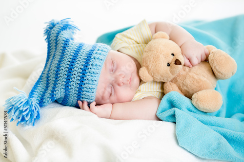 sleeping baby boy with toy