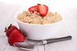 bowl of oat flakes and strawberry