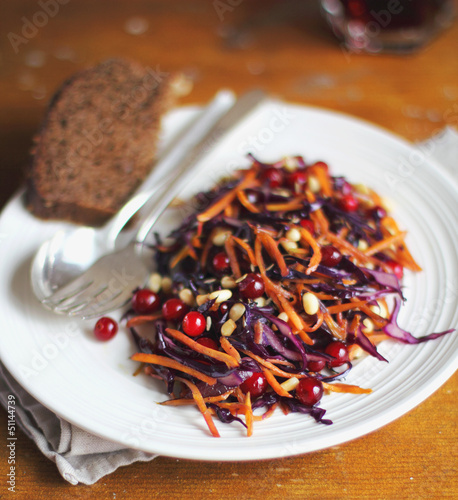 Portion of warm salad with red cabbage