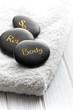 spa stones on white towel