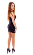Young pretty woman wearing black evening dress and posing in stu