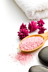 pink bath salt on wooden spoon