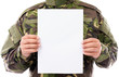 Portrait of a soldier holding white sheet of paper