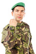 Serious young soldier with arm raised showing his fist