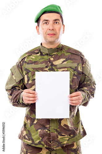 Young soldier holding white sheet of paper