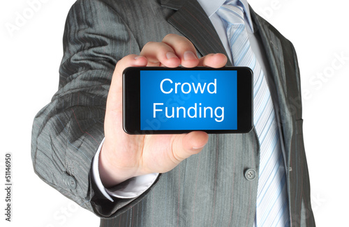 Businessman holds smart phone with crowd funding words