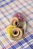 Rolls of herring fillets with lemon and onion
