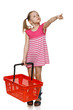 Little girl holding empty shopping basket, pointing to side