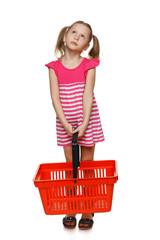 Little girl in ful length holding empty shopping basket