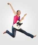 young woman playing on electro guitar