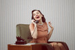 Cheerful woman talking on landline phone