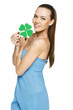 Beautiful girl holding shamrock leaf isolated on white