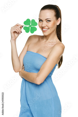 Beuatiful girl holding shamrock leaf isolated on white