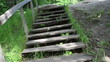 climb upstair wooden stair old stone pagan altar on top of hill