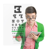 Young  man checking his vision using hologram test poster