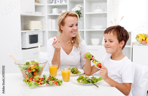 Woman and little boy having a healthy snack
