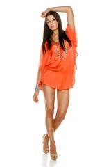 Fashion woman poising in light summer dress in full length