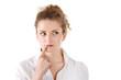 Nachdenkliche junge Frau isoliert mit weißer Bluse