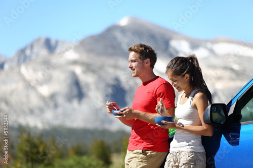 Couple on car road trip travel in Yosemite eating