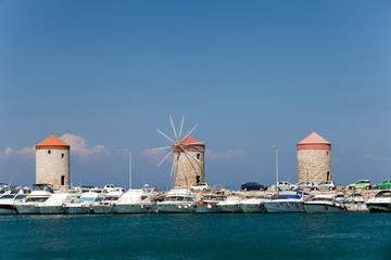 Mandraki Harbour in the Dodecanese island of Rhodes, Greece.