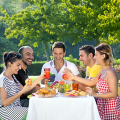 Multiethnic friends sharing an enjoyable meal