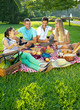 canvas print picture - Two couples picnicking in a park