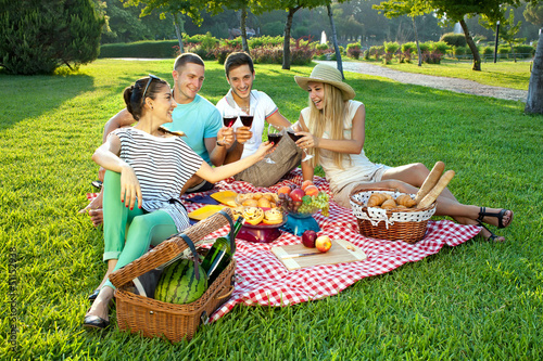 Young friends picnicking in the park
