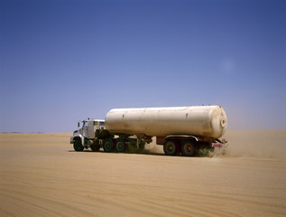 Truck driving through the Arab desert