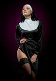 Sexy young nun posing indoors