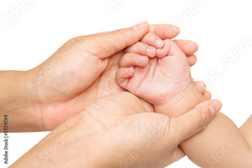 baby massage,Mother hand massaging hand of her baby