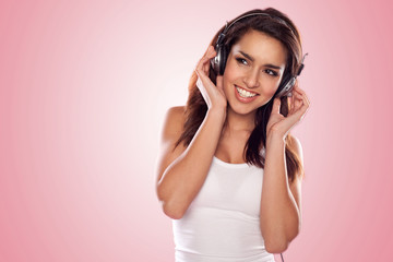 brunette woman listening to the music