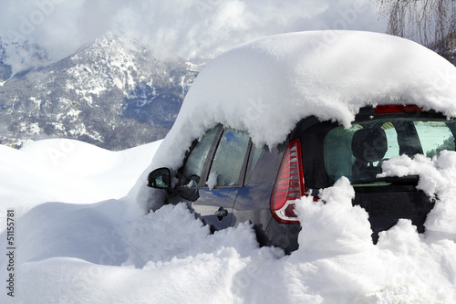 Car burried under snow in Alps