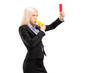 Young businesswoman blowing a whistle and showing a red card