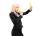 Young businesswoman blowing a whistle and showing a yellow card