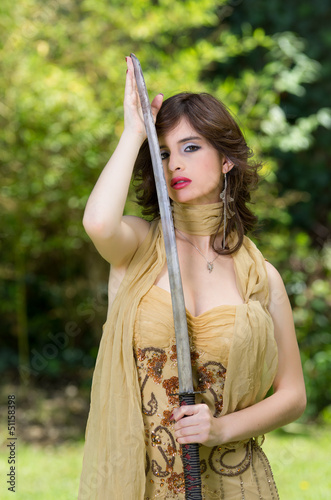 Beautiful female fighter with a sword