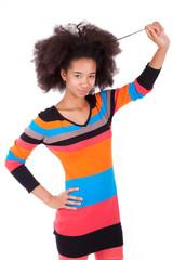 Black African American teenage girl holding her afro hair