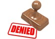 Denied word on wooden stamp
