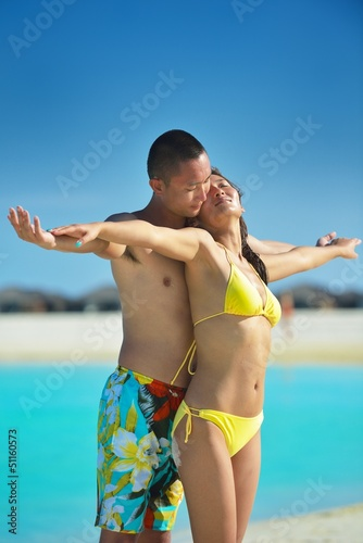 happy young  couple enjoying summer on beach