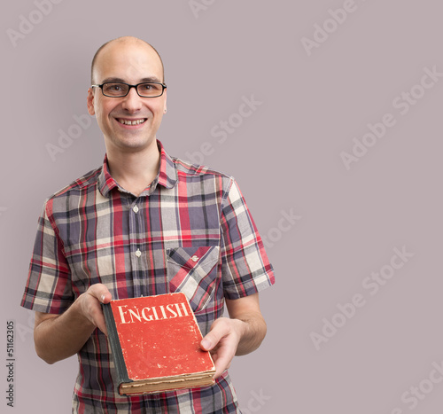 learning english. Male student with book