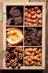 Nuts, cinnamon, raisins and dry fruits as an ingredient for dess