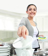 smiling woman happily washing dishes
