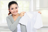 young woman showing clean clothes