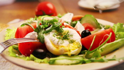 French national meal : Poached egg with salad with olive oil