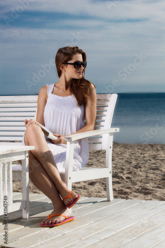 Preety young woman relaxing on the beach