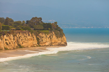 Rough coast with cliffs and vegetation. Malibu. USA. California.