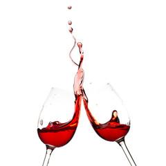 Splash of red wine in two glasses.
