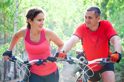 mature couple on  bicycle